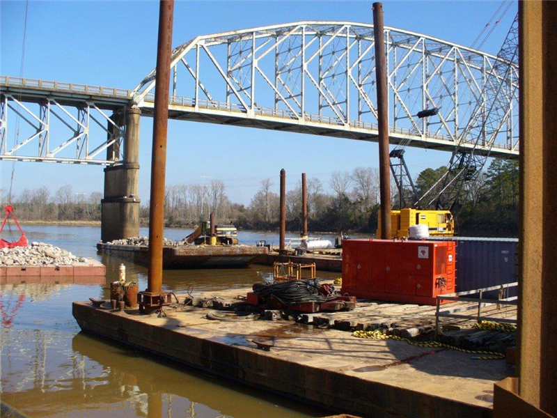 Looking north, barge is excavating rock out of the river (February 2011)