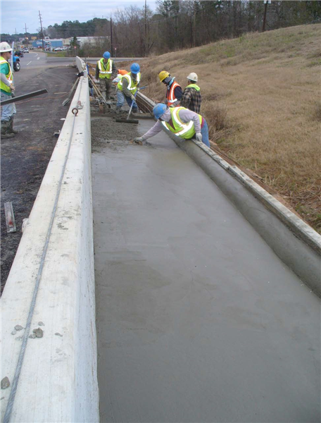 Pouring and finishing concrete for coping on MSE wall(March 2013)