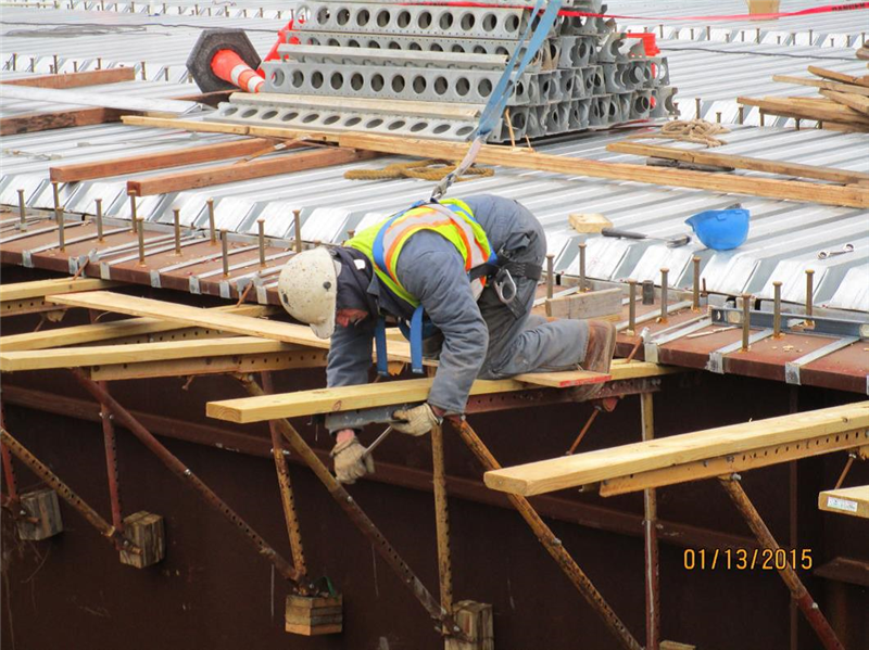 Installing over hang jacks for the overhang deck forms