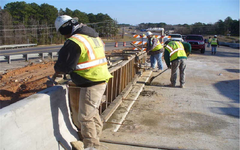 Pouring concrete barrier rail for approach slab at KCS RR Overpass(January 2013)