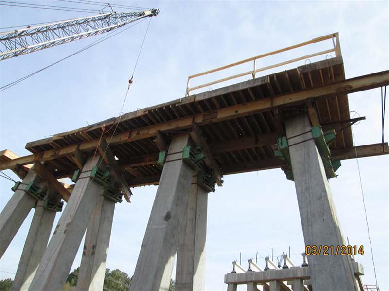 Installing beams and bottom cap forms at Bent 10