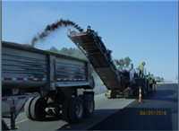 The R.A.P (Reclaimed Asphalt Pavement) being recycled