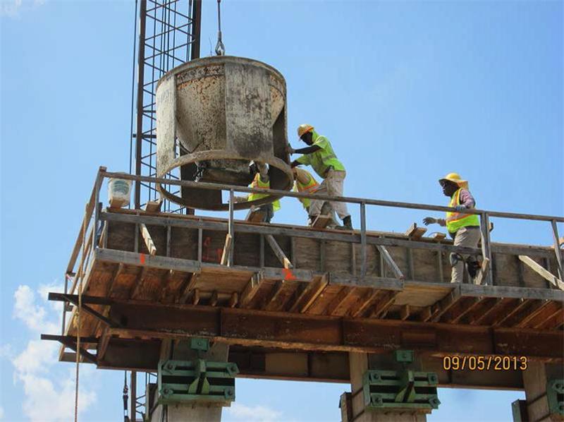Pouring concrete for cap at Bent 11, SB, KCS Overpass.