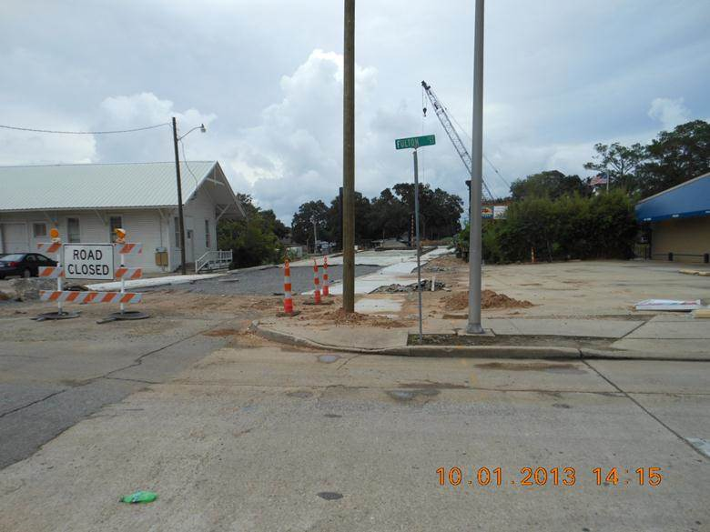All concrete sidewalks, drainage, and driveways have been completed. Stone base has been placed, asphalt remaining.