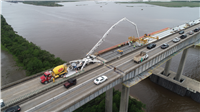 Construction crews pour concrete on the I-210 eastbound main span as part of the I-210 repair project.