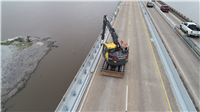 New guardrail is being installed on the eastbound I-210 Prien Lake Bridge.