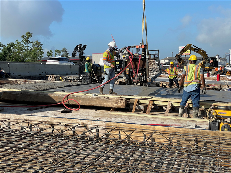 Crews complete a deck pour on the Maple Fork Bridge for the I-10 widening and improvements project in Sulphur.