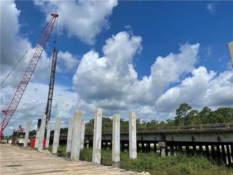 Crews drive piles for the Sabine Relief Bridge replacement.