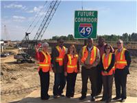 Segment J under construction at La. 1. U.S. DOT Secretary Foxx joins DOTD Secretary LeBas and others.