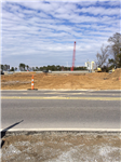 grading of future Cove Lane Extension sight (with Golden Nugget construction in background)