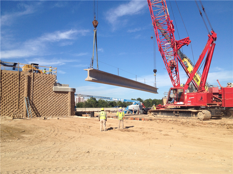 The installation of girders for the I-210 overpass over the future Cove Lane extension.