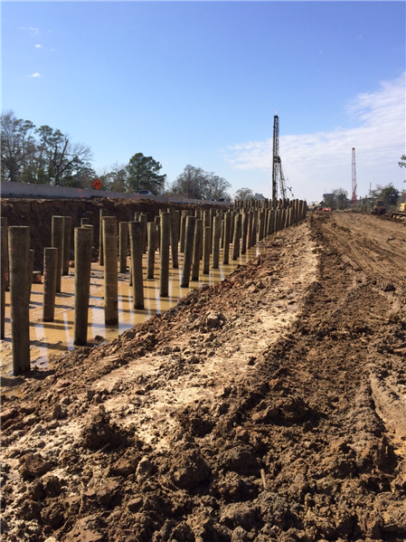 timber soil stabilization piles being driven