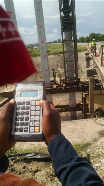 DOTD Engineering Tech monitors blow count during installation of new piles.