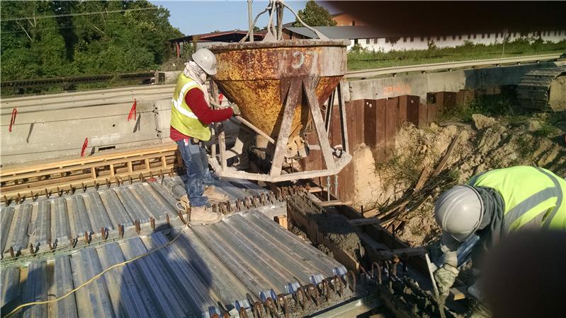 Contractor places concrete in end diaphragm on SB bridge