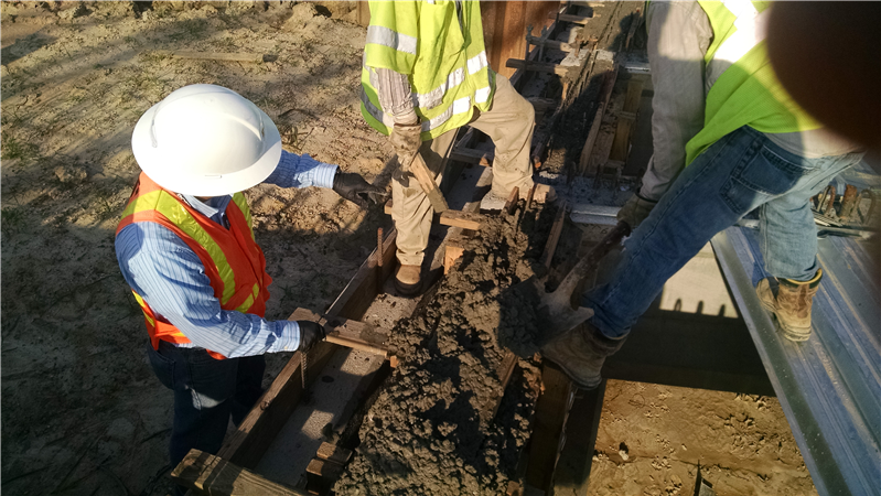 DOTD Engineering Tech Inspects concrete placement on end diaphragm on SB bridge