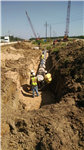 Contractor Installing new drainage pipe on Baker Canal Bridge job